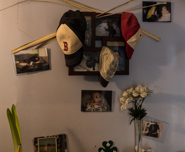 Memories hanging in the walkers home. The photos on the wall include both Jim and Jimmy as children.(Photo by Billy Bevevino)