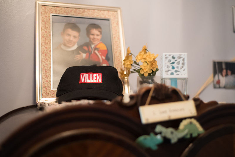 A villen (after Somerville) hat rests infront of a photo of Jim as a child. (Photo by Billy Bevevino)