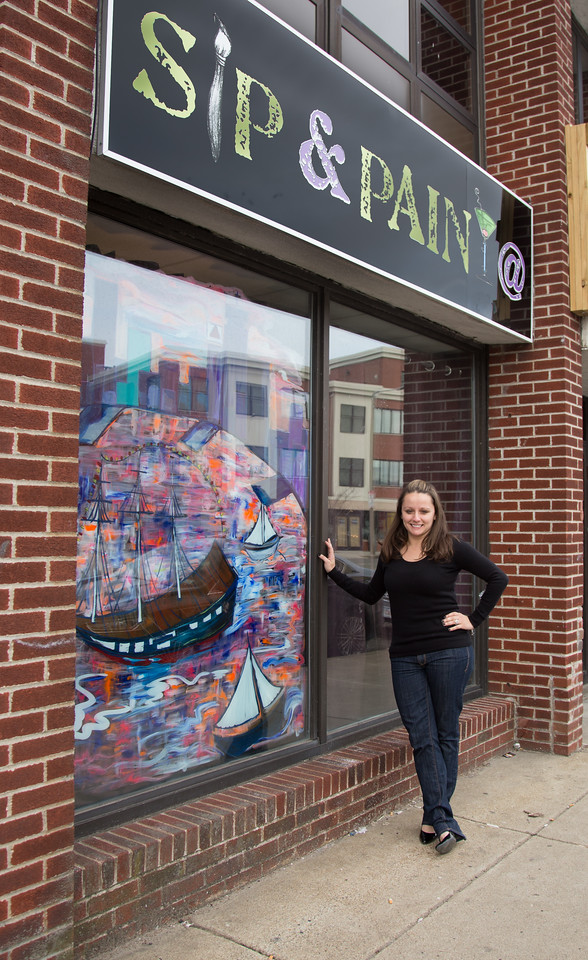 March 4, 2013 - Heather Carbone, co-owner of Urban Art Bar in South Boston, poses outside of the business for a portrait. Photo by Alexa Gonzalez Wagner.