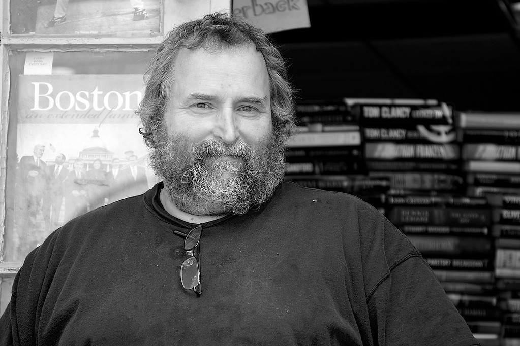 """March 30, 2013- Derby Square Book Store co-owner, Ted Monroe. """"We go to bookstores that are closing and we buy their old books. I'm in a collective with five or six other store owners and we each take different genres."""" Photo by: Jasmin Bleu Pellegrino"""