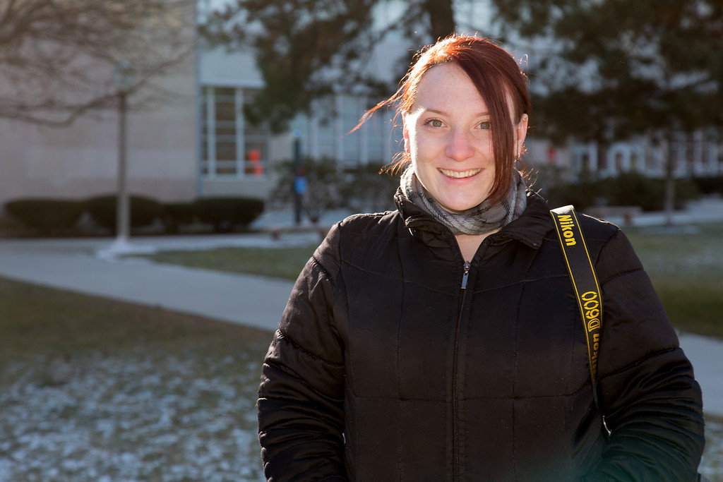 January 23, 2013 - Jasmin Pelligrino, a photojournalism graduate student, smiles for a portrait during a class assignment outside of the Boston University College of Communication. Photo by Alexa Gonzalez Wagner.