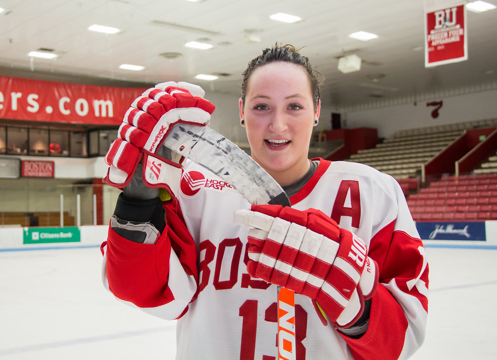 Boston, March 1, 2014 -- Boston University women's hockey defense Kaleigh Fratkin, center, poses for a portrait after the team won against Providence College in the East Quarterfinals. © Carolyn Bick 2014