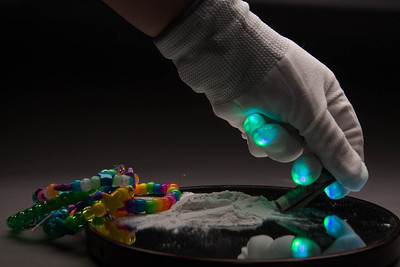 Raves are popular places for harder recreational drugs, such as Ecstasy or cocaine. © Carolyn Bick 2014