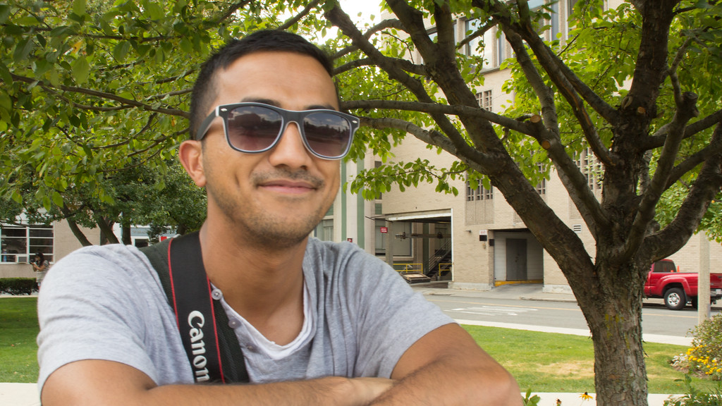 Pankay Khalda, photojournalism graduate student, poses for a picture outside of Boston University's College of Communication as part of a multimedia journalism project on September 6, 2014.