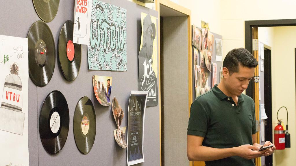 Max Rodriguez in the WBTU studio in Boston University's College of Communication.