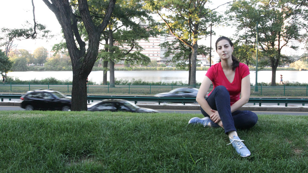Olya relaxing with Charles River in background