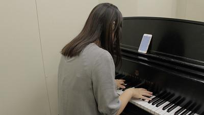 Jiaxun Fan at the boston university playing her piano
