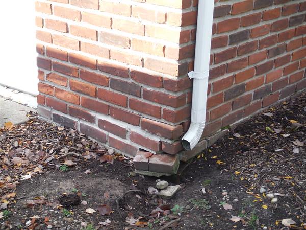 Brick repair on garage wall