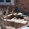 COURT YARD  WALLS UNDER CONSTRUCTION USING RECLAIMED COMMON BRICK