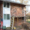 BRICK IN THE UPPER SECTION OF THIS WALL ARE COMPLETE.<br /> WALL WILL BE WASHED TO CLEAN OFF ALL DUST FROM REMOVAL OPERATION.