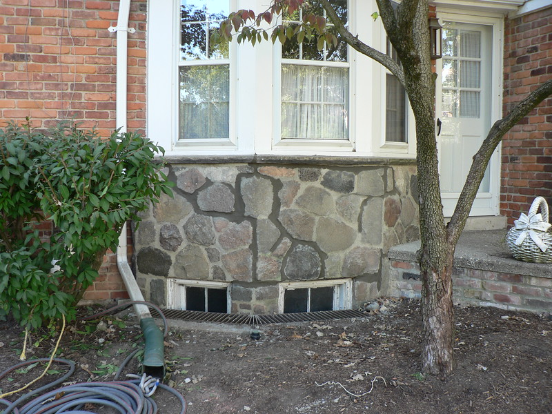 CRACKS ARE TUCK POINTED WITH NEW MORTAR. MORTAR IS TINTED SLIGHTLY<br /> DARKER THAN OLD MORTAR SO THAT WHEN IT DRIES IT WILL BLEND IN WITH<br /> THE REST OF THE WALL.