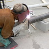 WELDING TO COMPLETE TOP BRACKET.