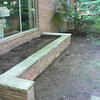PLANTER REBUILT USING OLD BRICK AND STONE