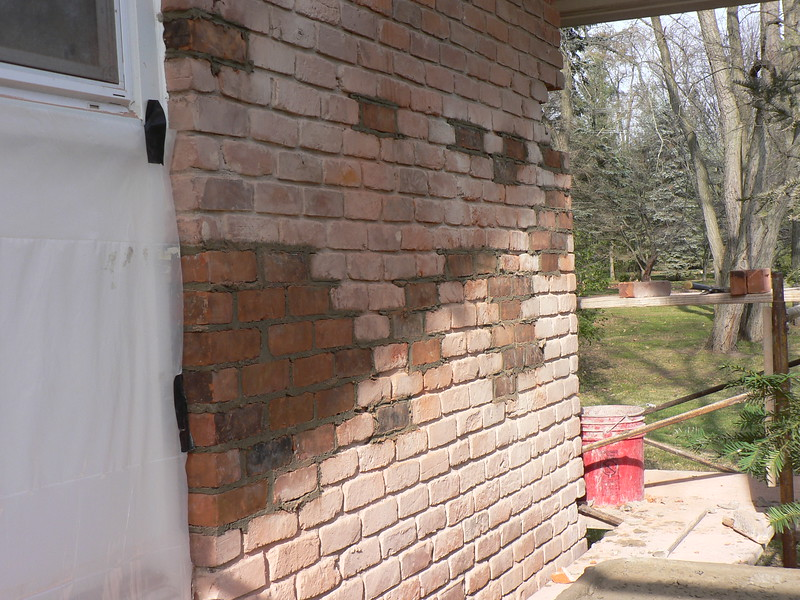 BRICK ARE BEING REPLACED ON THE NEXT SECTION OF WALL.