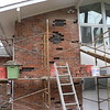 BRICK REMOVAL CONTINUES TO NEXT AREA OF HOUSE.