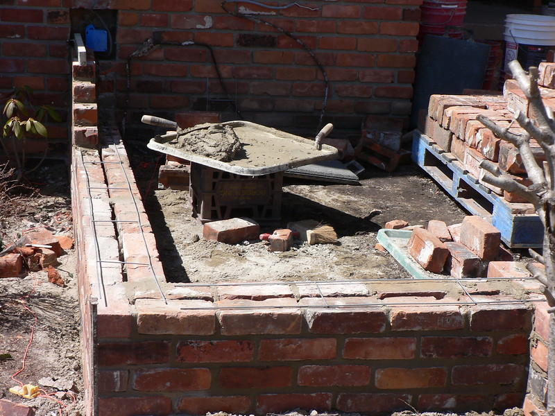 COURT YARD  WALLS UNDER CONSTRUCTION USING RECLAIMED COMMON BRICK SHOWING REINFORCEMENT