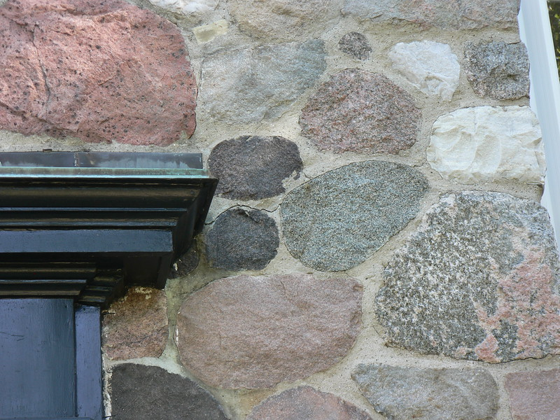 FIELD STONE ON THE FRONT OF THIS HOUSE HAD CRACKS IN MORTAR JOINTS THAT NEEDED REPAIR.