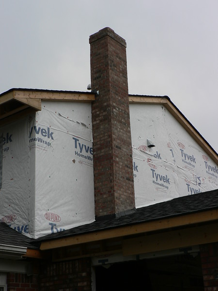 BRICK WORK COMPLETE SHOWING CHIMNEY