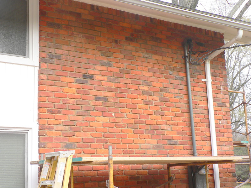 UPPER PORTION OF WALL HAS BEEN WASHED. SCAFFOLD WILL BE REMOVED AND BRICK WILL BE REMOVED AND REPLACED IN LOWER SECTION OF WALL.