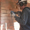 MORTAR JOINTS ARE FIRST REMOVED BEFORE TAKING THE BRICK OUT SO THAT AS LITTLE DAMAGE AS POSSIBLE WILL OCCUR TO SURROUNDING BRICKS.