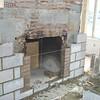 FIREPLACE BEING REBUILT AFTER FIRE