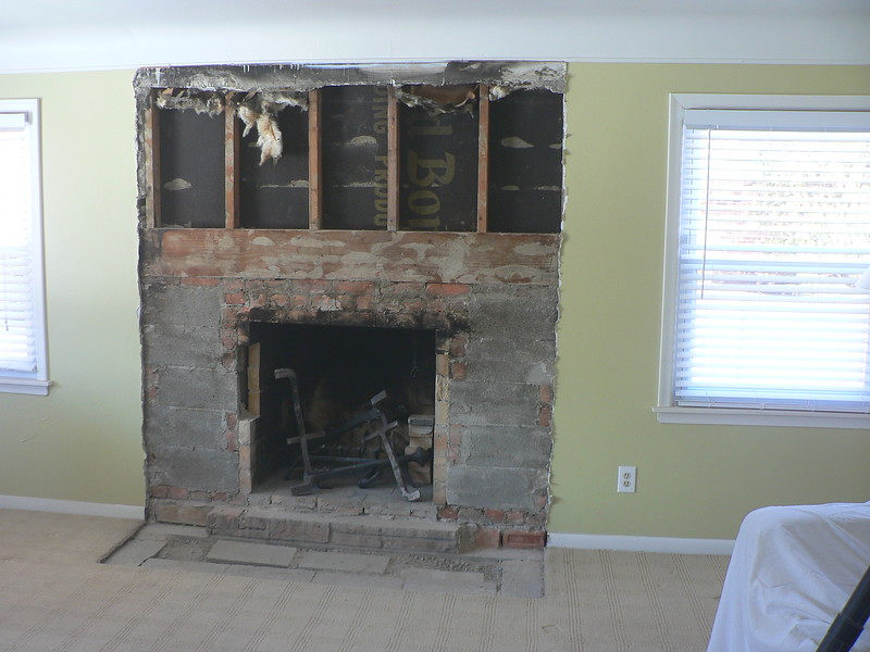 TEARING OUT AN OLD OUTDATED FIREPLACE FACE AND HEARTH
