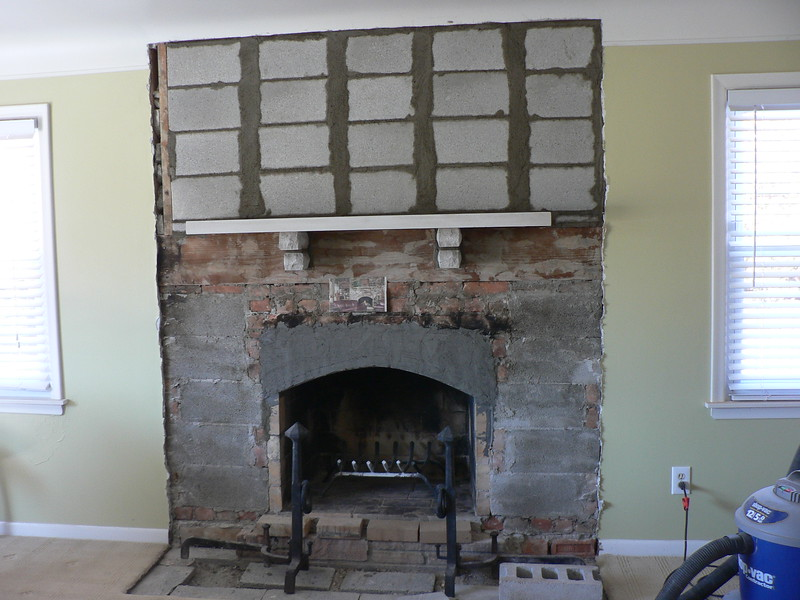 NEW ARCH INSTALLED. BACK UP BLOCK INSTALLED. NEW LIMESTONE MANTEL IN PLACE