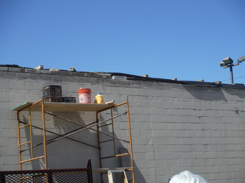 Block damage to commercial building from wind storm