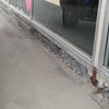 Replacement of masonry on front of commercial building