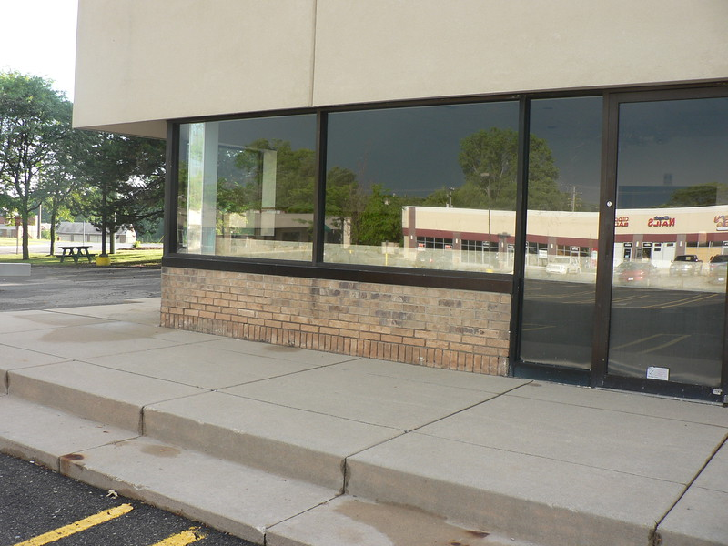 """THIS JOB HAD DETERIORATED BRICK IN THE LOWER 24"""" OF THE BUILDING. THE REMEDY WAS TO REMOVE ALL OF THE BRICK WORK AND REPLACE WITH NEW 4"""" BURNISHED BLOCK.<br /> THESE PICTURES SHOW THE BUILDINGS BEFORE."""