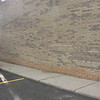 "THIS JOB HAD DETERIORATED BRICK IN THE LOWER 24"" OF THE BUILDING. THE REMEDY WAS TO REMOVE ALL OF THE BRICK WORK AND REPLACE WITH NEW 4"" BURNISHED BLOCK.<br /> THESE PICTURES SHOW THE BUILDINGS BEFORE."