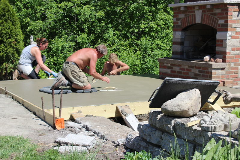 Patio is being finished. A surface  retarder will be sprayed on the surface and power washed off to expose the aggregate.