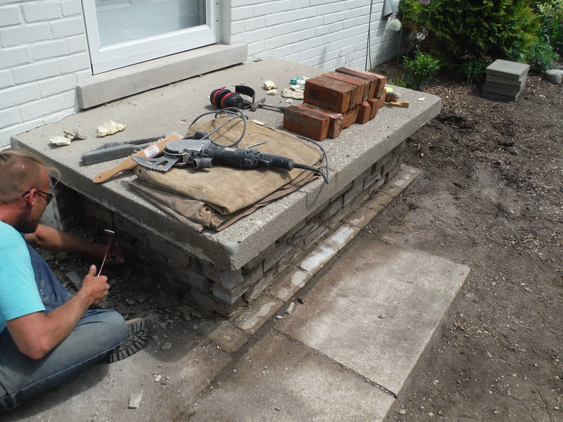 Brick and step replacement on front porch.