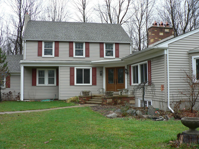 THIS IS WHAT THE HOUSE LOOKED LIKE BEFORE THE NEW PORCH WAS BUILT.