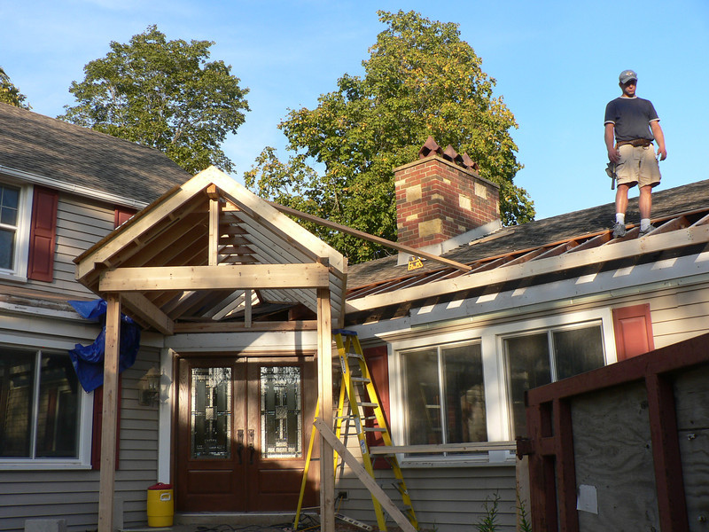 BUILDING NEW SOFFIT TO MATCH EXISTING ON OTHER SIDE. TEAR OFF OF OLD ROOF STARTED