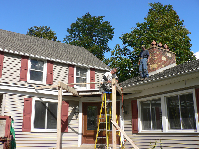 CARPENTERS START PORCH ROOF COVER AND SHED ROOF
