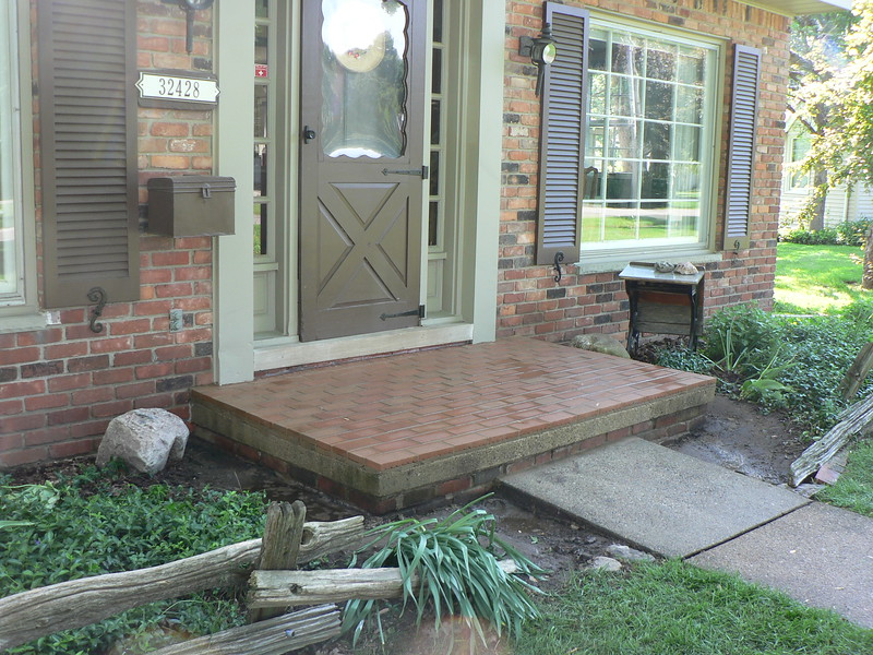 "1.25"" pavers were installed on the front and back porches at this home."