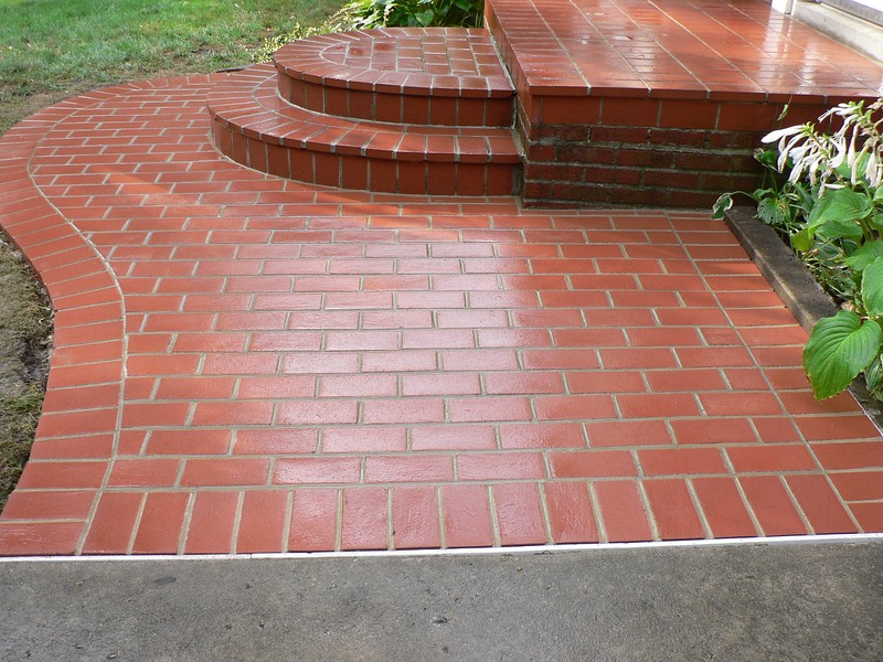 OLD PAVING BRICK HAVE BEEN POWER WASHED TO BRING BACK THE ORIGINAL COLOR AS CLOSELY AS POSSIBLE. THE OLD BRICK AND THE NEW BRICK ARE MADE BY THE SAME MANUFACTURER.