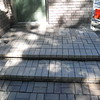 Paving brick and steps have settled and need to be rebuilt.