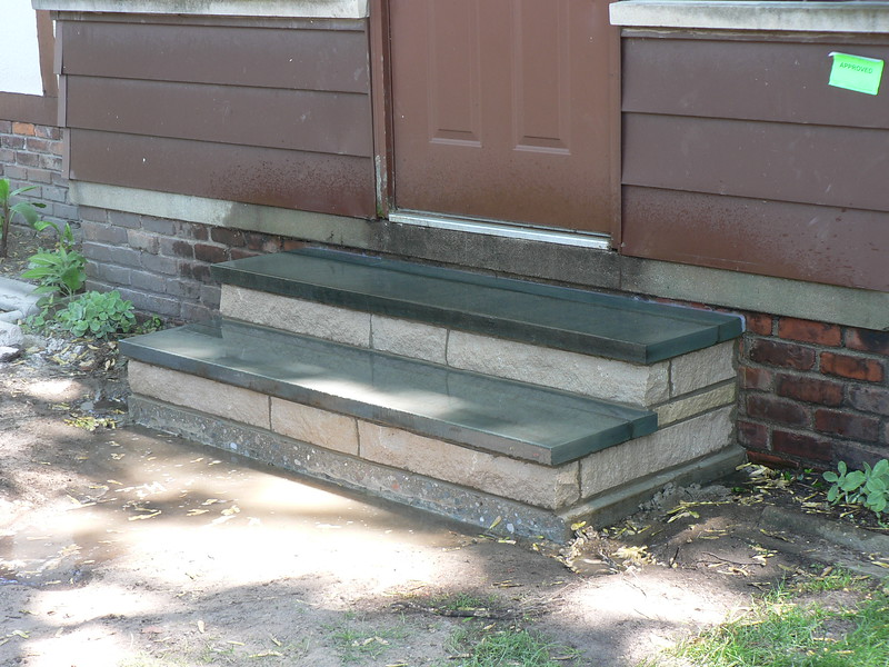 STEPS ARE COMPLETE. WALK WAY WILL BE INSTALLED AT  A  LATER DATE.
