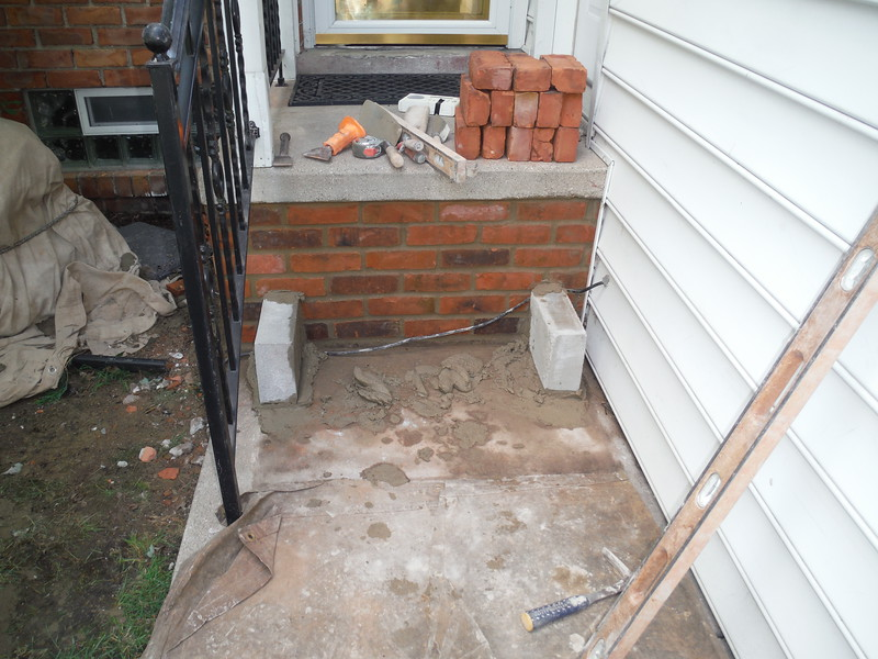 Step and brick replacement on porch