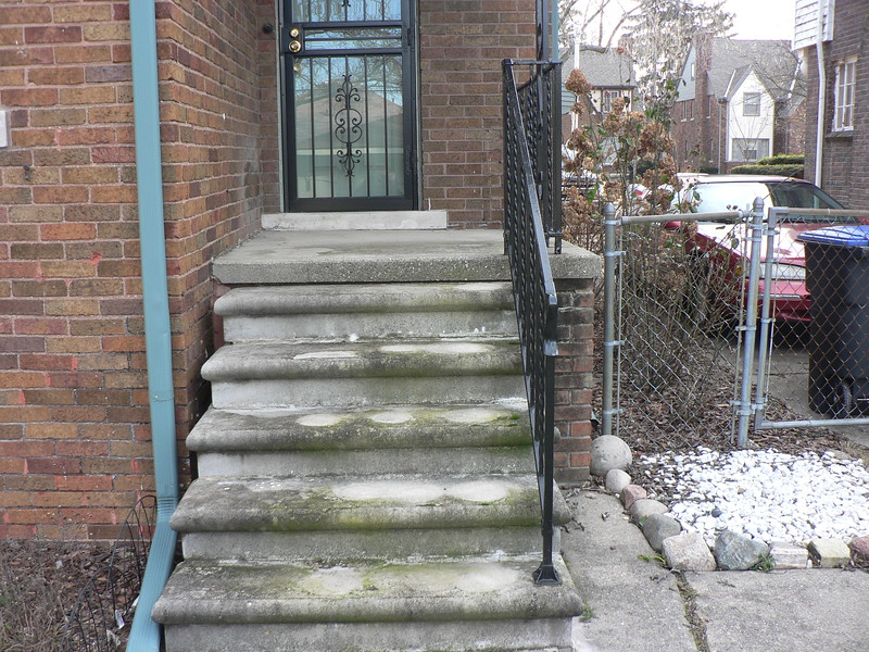THESE STEPS AND RAILINGS ARE OLD AND HAVE BECOME DANGEROUS TO USE.