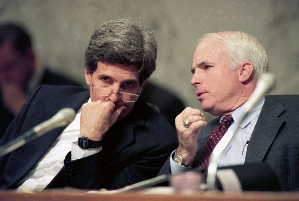 . FILE - In this Dec. 1, 1992, file photo, Sen. John Kerry, D-Mass., left, chairman of the Senate Select Committee on POW/MIA Affairs, listens to Sen. John McCain, R-Ariz., a former POW in Vietnam, during a hearing of the committee on Capitol Hill in Washington. Arizona Sen. McCain, the war hero who became the GOP\'s standard-bearer in the 2008 election, has died. He was 81. His office says McCain died Saturday, Aug. 25, 2018. He had battled brain cancer. (AP Photo/Ron Edmonds, File)