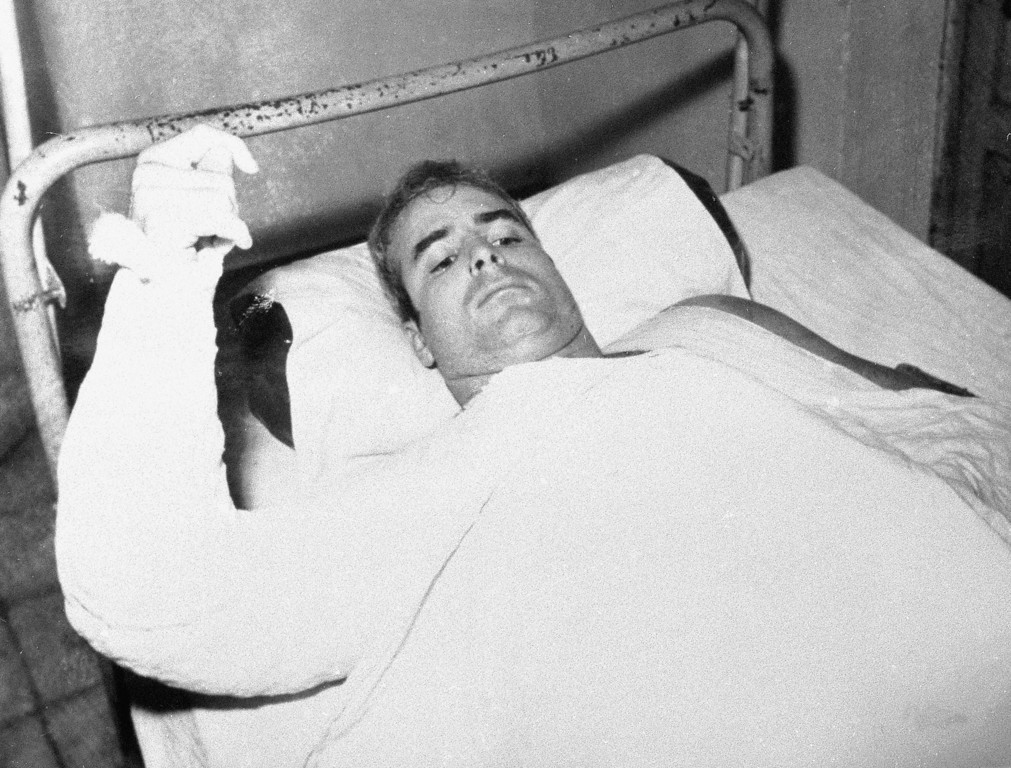 . FILE - In this undated file photo provided by CBS, U.S. Navy Lt. Commander John S. McCain lies injured in North Vietnam. McCain, the war hero who became the GOP\'s standard-bearer in the 2008 election, died Saturday, Aug. 25, 2018. He was 81. (CBS via AP, File)