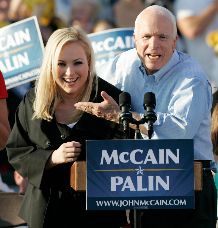 . FILE - In this Aug. 30, 2008, file photo, former Republican presidential candidate, Sen. John McCain, right, introduces his daughter Meghan at a campaign stop in Washington, Pa. John McCain, the war hero who became the GOP\'s standard-bearer in the 2008 election, died Saturday, Aug. 25, 2018. He was 81. (AP Photo/Keith Srakocic, File)