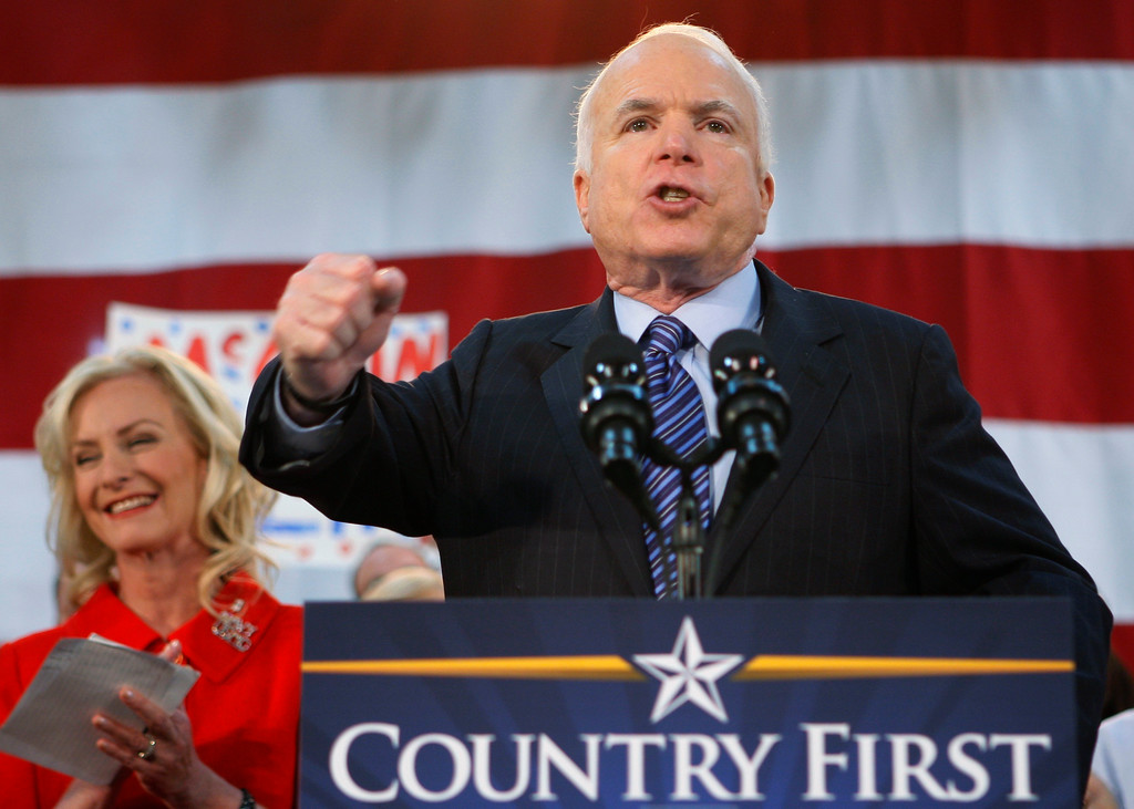. FILE - In this Oct. 21, 2008 file photo, Republican presidential candidate Sen. John McCain, R-Ariz., standing with his wife Cindy, encourages his supporters to stand up and fight for America at the close of his address during a campaign rally in Bensalem, Pa. McCain�s family says the Arizona senator has chosen to discontinue medical treatment for brain cancer.  (AP Photo/Stephan Savoia)