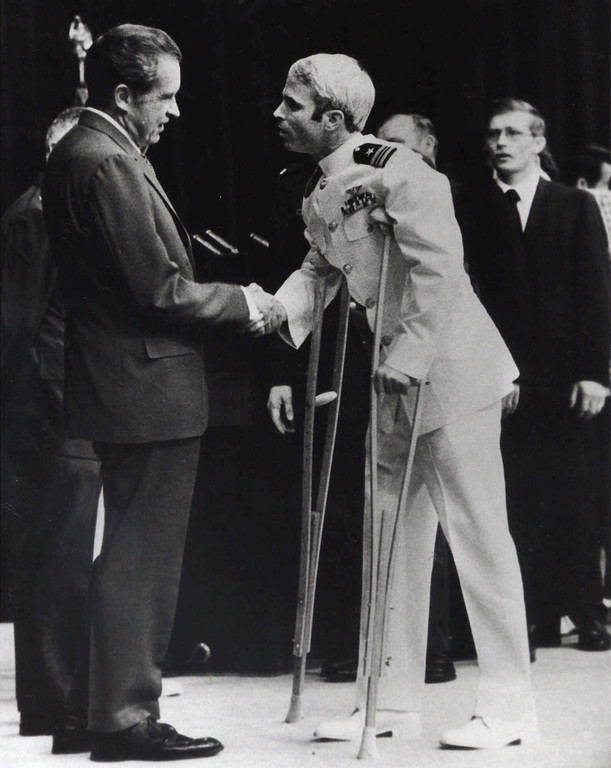 . FILE - In this May 25, 1973, file photo, U.S. Navy Lt. Cmdr. John McCain is greeted by President Richard Nixon, left, in Washington, after McCain\'s release from a prisoner of war camp in North Vietnam. An aide says that McCain died Saturday, Aug. 25, 2018. He was 81. (AP Photo/Harvey Georges, File)