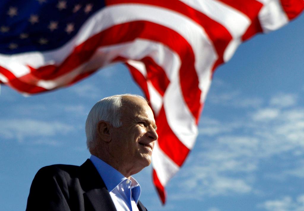 . FILE - In this Nov. 3, 2008, file photo, Republican presidential candidate Sen. John McCain, R-Ariz., speaks at a rally in Tampa, Fla. Aide says senator, war hero and GOP presidential candidate McCain died Saturday, Aug. 25, 2018. He was 81. (AP Photo/Carolyn Kaster, File)