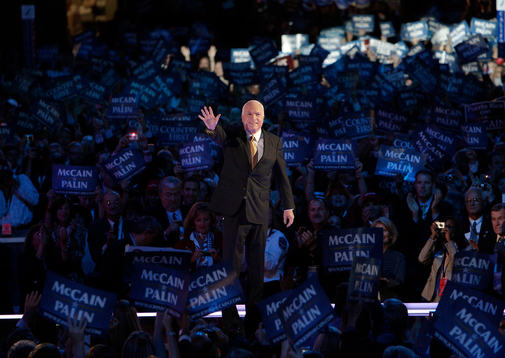 . FILE - In this Sept. 4, 2008, file photo, Republican presidential candidate John McCain acknowledges the crowed as he goes on stage at the Republican National Convention in St. Paul, Minn. Aide says senator, war hero and GOP presidential candidate McCain died Saturday, Aug. 25, 2018. He was 81. (AP Photo/Paul Sancya, File)