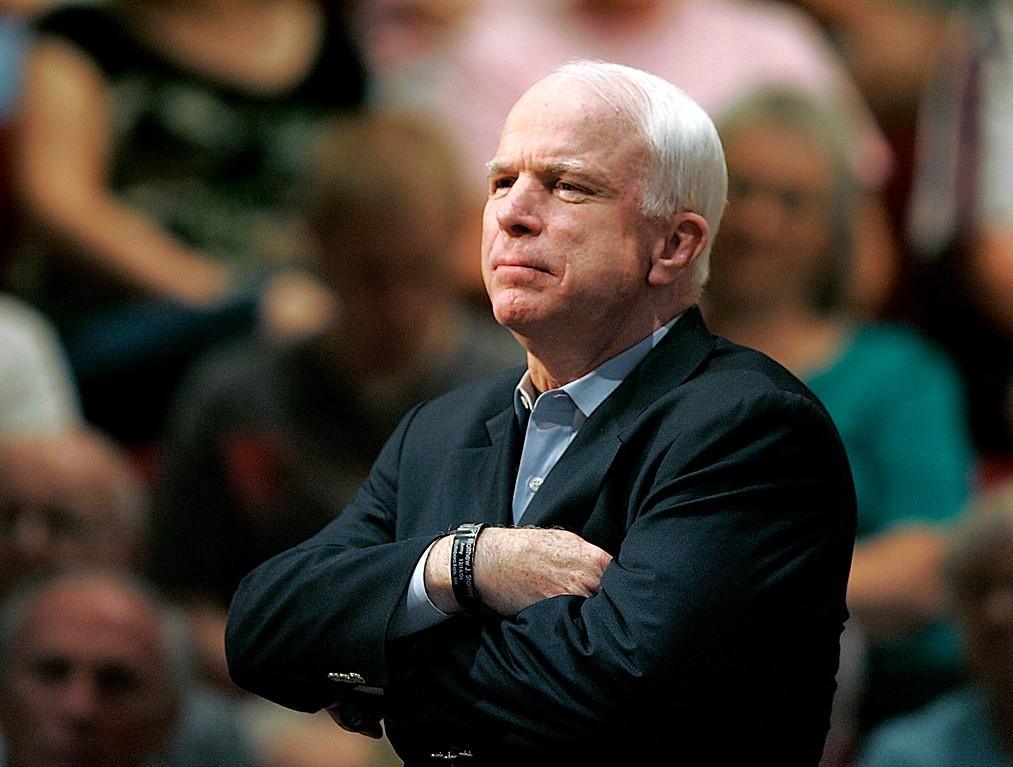 . FILE - In this Aug. 25, 2009 file photo, Sen. John McCain, R-Ariz., holds a healthcare town hall meeting in Sun City, Ariz. McCain\'s family says the Arizona senator has chosen to discontinue medical treatment for brain cancer.   (AP Photo/Matt York)